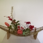 "Floral in twig ""boat"" shape"